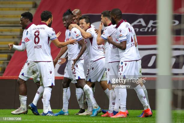 Edgar Ie of Trabzonspor celebrates scoring a goal with teammates during the Super Lig match between Galatasaray and Trabzonspor at Turk Telekom...