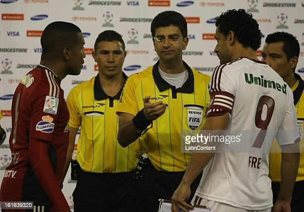 Edgar Jimenez de Caracas FC and Fred of Fluminense throw the coin before a game between Fluminense FC and Caracas as part of the Copa Bridgestone...