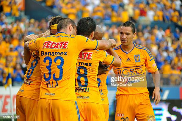 Edgar Lugo of Tigres celebrates with teammates after scoring a goal during a match between Tigres UANL and Leones Negros as part of 9th round...