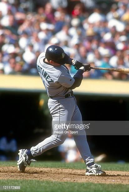 Edgar Martinez of the Seattle Mariners bats against the Oakland Athletics during an Major League Baseball game circa 1996 at the OaklandAlameda...