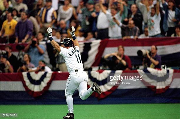 Edgar Martinez of the Seattle Mariners hits a threerun home run in the third inning of Game four of the 1995 American League Divisional Series...