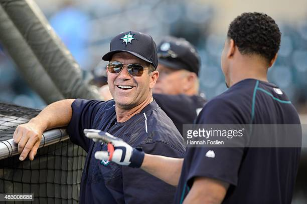 Edgar Martinez of the Seattle Mariners speaks with Nelson Cruz during batting practice before the game against the Minnesota Twins on July 30 2015 at...