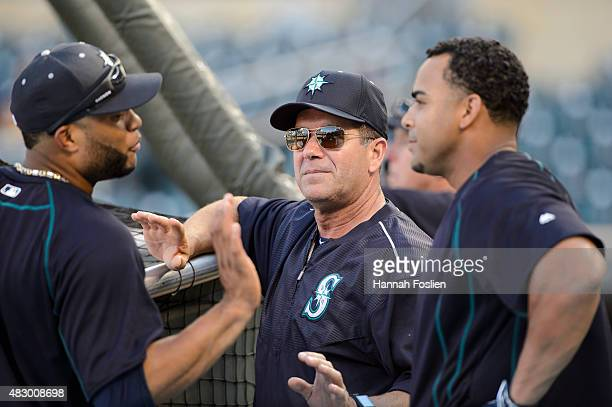 Edgar Martinez of the Seattle Mariners speaks with Robinson Cano and Nelson Cruz during batting practice before the game against the Minnesota Twins...