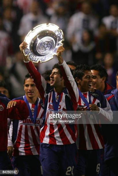 Edgar Mejia of CD Chivas USA holds up the InterLiga trophy after they defeated Morelia 42 in penalty kicks after a 11 draw during their InterLiga...