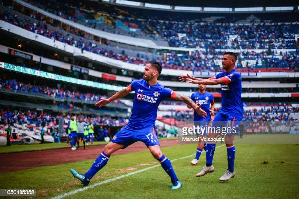 Edgar Mendez celebrates with teammate Elias Hernandez of Cruz Azul after scoring the winning goal during the 12th rond match between Cruz Azul and...