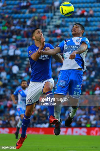 Edgar Mendez of Cruz Azul and Anderson Santamaria of Puebla go for a header during the 8th round match between Cruz Azul and Puebla as part of the...