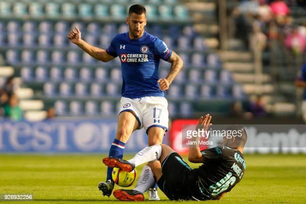 Edgar Mendez of Cruz Azul and Miguel Zamudio of Queretaro fight for the ball during the 10th round match between Cruz Azul and Queretaro as part of...