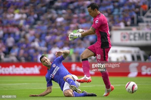 Edgar Mendez of Cruz Azul and Rodolfo Cota goalkeeper of Chivas during the 2nd round match between Cruz Azul and Chivas as part of the Torneo...
