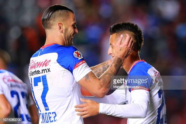 Edgar Mendez of Cruz Azul celebrates a scored goal with Roberto Alvarado of Cruz Azul during the quarter finals first leg match between Queretaro and...