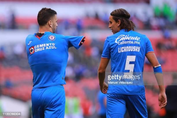 Edgar Mendez of Cruz Azul celebrates after scoring the second of his team with Igor Lichnovsky of Cruz Azul during the 9th round match between Cruz...