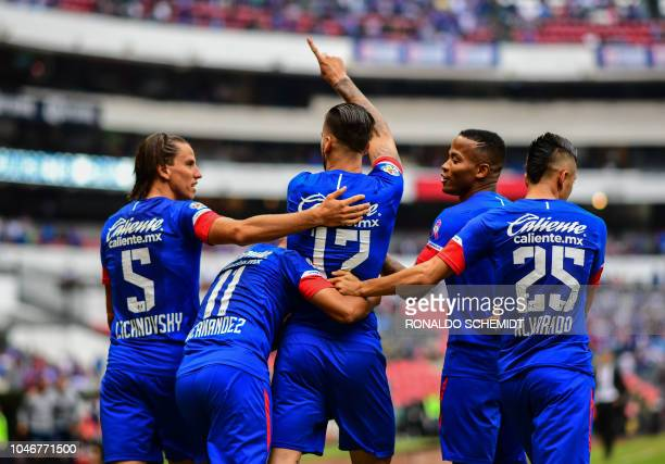 Edgar Mendez of Cruz Azul celebrates his goal against Monterrey with teammates during their Mexican Apertura 2018 tournament football match at the...