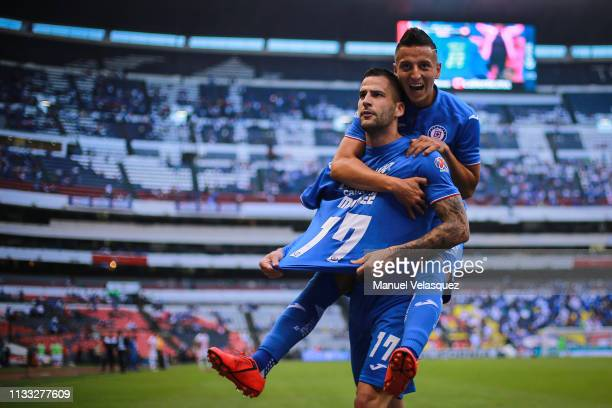 Edgar Mendez of Cruz Azul celebrates with teammate Roberto Alvarado of Cruz Azul after scoring the second goal of his team during the 9th round match...