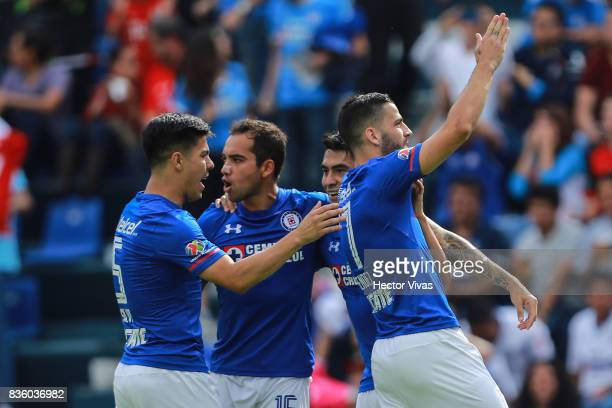 Edgar Mendez of Cruz Azul celebrates with teammates after scoring the first goal of his team during the fifth round match between Cruz Azul and Atlas...