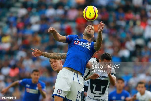Edgar Mendez of Cruz Azul heads the ball during the 12th round match between Cruz Azul and Pumas UNAM as part of the Torneo Clausura 2018 Liga MX at...