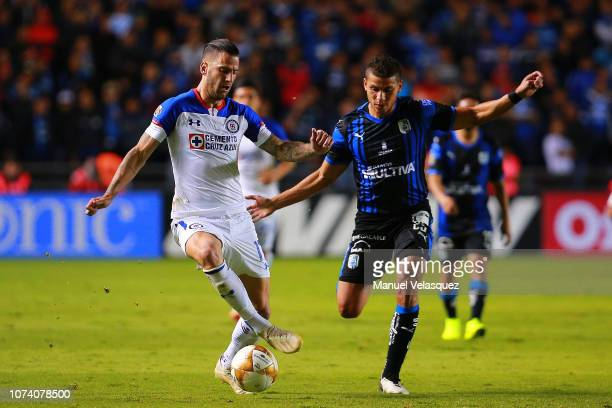 Edgar Mendez of Cruz Azul struggle for the ball against Alexis Perez of Queretaro during the quarter finals first leg match between Queretaro and...