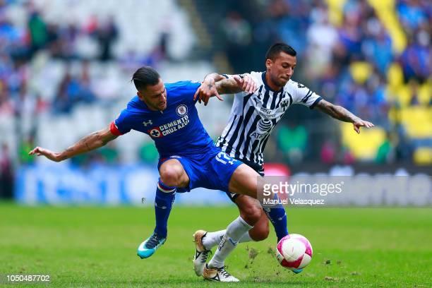 Edgar Mendez of Cruz Azul struggles for the ball against Leonel Vangioni of Monterrey during the 12th rond match between Cruz Azul and Monterrey as...