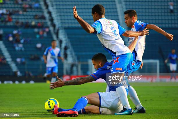 Edgar Mendez of Cruz Azul struggles for the ball with Brayan Angulo and Alonso Zamora of Puebla during the 8th round match between Cruz Azul and...