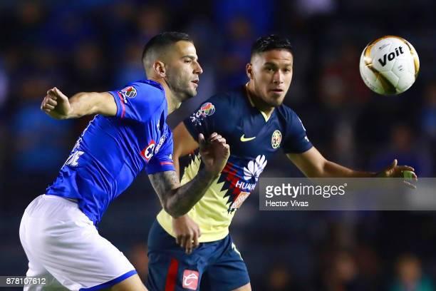 Edgar Mendez of Cruz Azul struggles for the ball with Bruno Valdez of America during the quarter finals first leg match between Cruz Azul and America...
