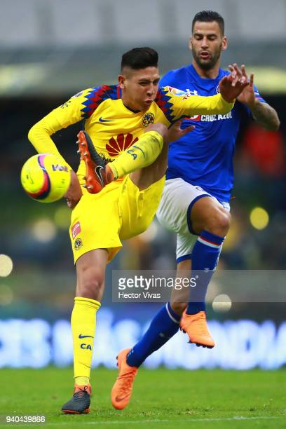 Edgar Mendez of Cruz Azul struggles for the ball with Edson Alvarez of America during the 13th round match between America and Cruz Azul as part of...