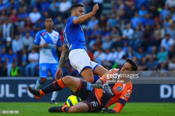 Edgar Mendez of Cruz Azul struggles for the ball with Moises Munoz goalkeeper of Puebla during the 8th round match between Cruz Azul and Puebla as...