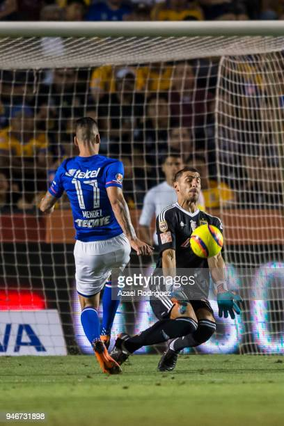 Edgar Mendez of Cruz Azul tries to score over Nahuel Guzman goalkeeper of Tigres during the 15th round match between Tigres UANL and Cruz Azul as...