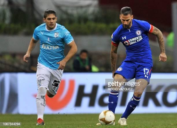 Edgar Mendez of Cruz Azul vies for the ball with Javier Guemez of Queretaro during a Mexican Apertura 2018 tournament second leg quarterfinal...