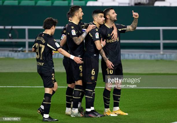 Edgar Mendez of Deportivo Alaves celebrates after scoring his team's second goal with his teammates during the La Liga Santander match between Real...