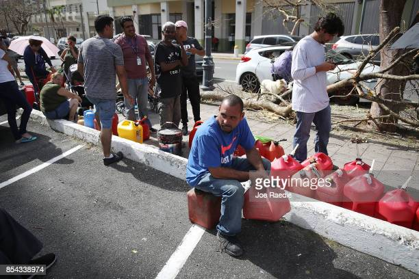 Edgar Morales sits and waits in line to get gas as he deals with the aftermath of Hurricane Maria on September 26 2017 in San Juan Puerto Rico Puerto...