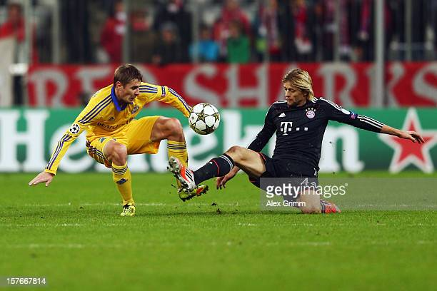 Edgar Olekhnovich of Borisov is challenged by Anatoliy Tymoshchuk of Muenchen during the UEFA Champions League Group F match between FC Bayern...
