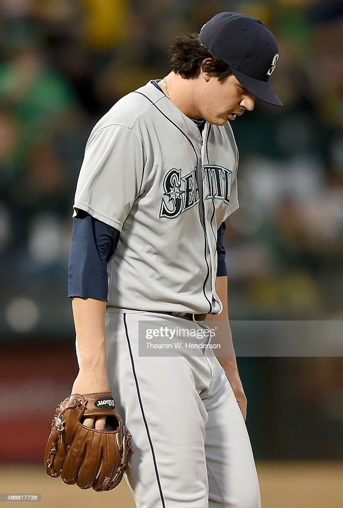 Edgar Olmos #49 of the Seattle Mariners reacts after giving up a grand slam home run to Danny Valencia #26 of the Oakland Athletics in the bottom of the first inning at O.co Coliseum on September 4, 2015 in Oakland, California.