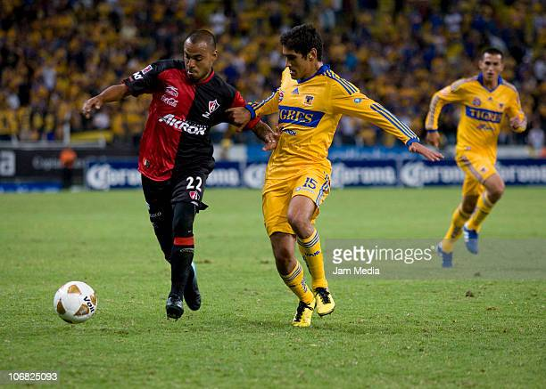 Edgar Pacheco of Atlas vies for the ball with Manuel Viniegra of Tigres during a match as part of the Apertura 2010 at Jalisco Stadium on November 13...