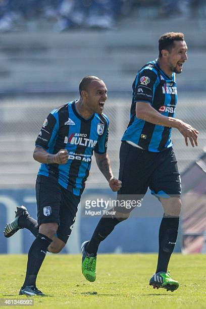 Edgar Pacheco of Queretaro celebrates after scoring the first goal of his team during a match between Pumas and Queretaro as part of 1st round...