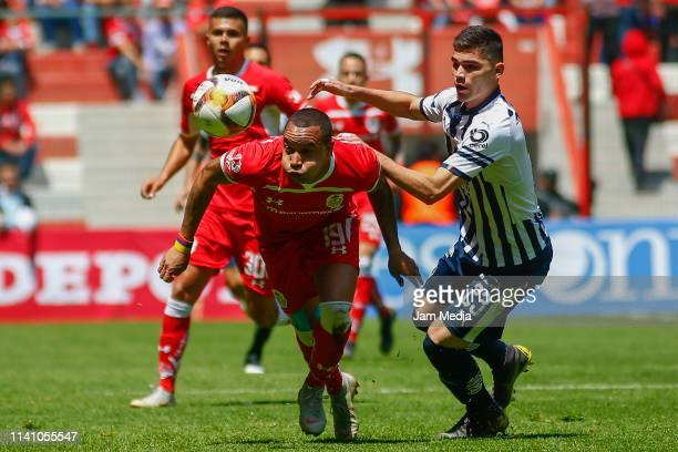 Edgar Pardo of Toluca and Johan Vasquez of Monterrey fight for the ball during the 13th round match between Toluca and Monterrey as part of the...
