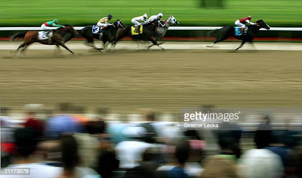 Edgar Prado rides Songster the horse on his way to winning the 'The Woody Stephens Breeders' Cup' before the 138th running of of the Belmont Stakes...