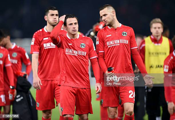 Edgar Prib and Alexander Milosevic of Hannover 96 during the Bundesliga match between Hertha BSC and Hannover 96 at Olympiastadion on April 8 2016 in...
