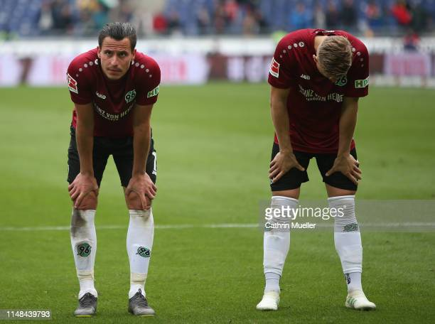 Edgar Prib and Matthias Ostrzolek of Hannover 96 are disappointed during the Bundesliga match between Hannover 96 and SportClub Freiburg at HDIArena...