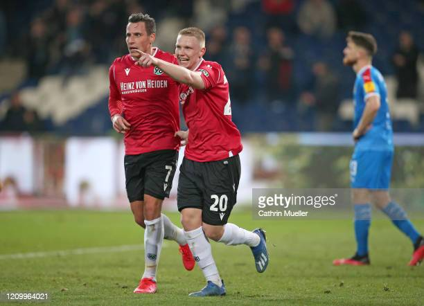 Edgar Prib and Philipp Ochs of Hannover 96 celebrate after scoring a goal during the Second Bundesliga match between Hannover 96 and Holstein Kiel at...