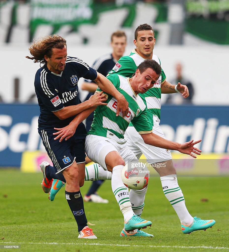 Edgar Prib (R) of Greuther Fuerth is challenged by Petr Jiracek of Hamburg during the Bundesliga match between SpVgg Greuther Fuerth and Hamburger SV at Trolli-Arena on October 6, 2012 in Fuerth, Germany.