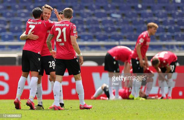 Edgar Prib of Hannover 96 celebrates with his team mates after scoring his team's second goal during the Second Bundesliga match between Hannover 96...