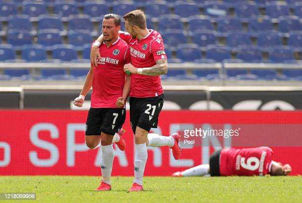 Edgar Prib of Hannover 96 celebrates with Jannes-Kilian Horn after scoring his team's second goal during the Second Bundesliga match between Hannover...