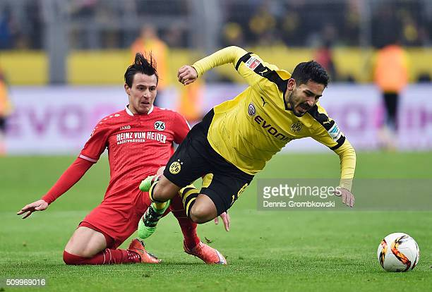 Edgar Prib of Hannover 96 challenges Ilkay Guendogan of Borussia Dortmund during the Bundesliga match between Borussia Dortmund and Hannover 96 at...