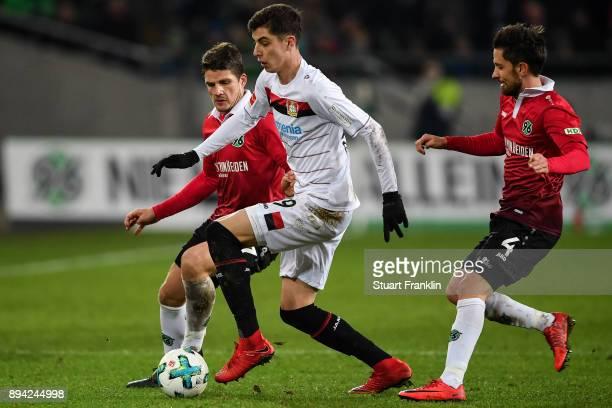 Edgar Prib of Hannover 96 Kai Havertz of Bayer Leverkusen and Julian Korb of Hannover 96 battle for the ball during the Bundesliga match between...