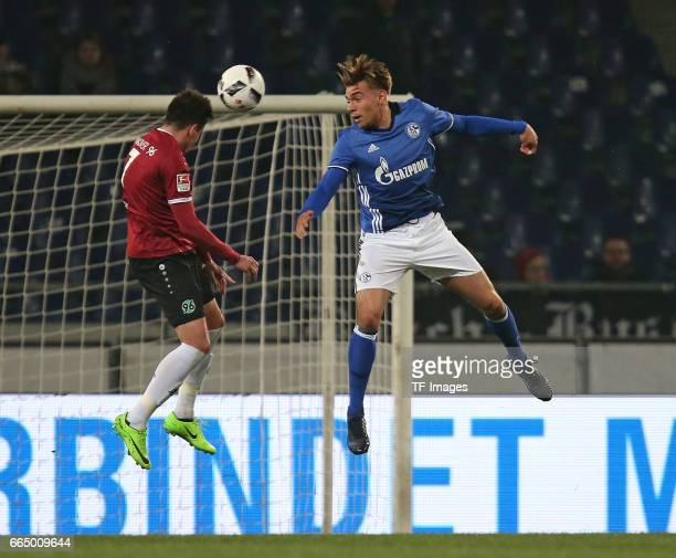 Edgar Prib of Hannover and Joshua Bitter of Schalke battle for the ball during the friendly match between Hannover 96 an FC Schalke 04 at HDIArena on...