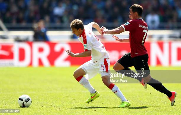 Edgar Prib of Hannover and Julian Schauerte of Duesseldorf battle for the ball during the Second Bundesliga match between Hannover 96 and Fortuna...