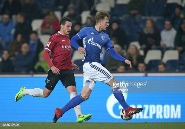 Edgar Prib of Hannover and Tjorben Uphoff of Schalke battle for the ball during the friendly match between Hannover 96 an FC Schalke 04 at HDIArena...