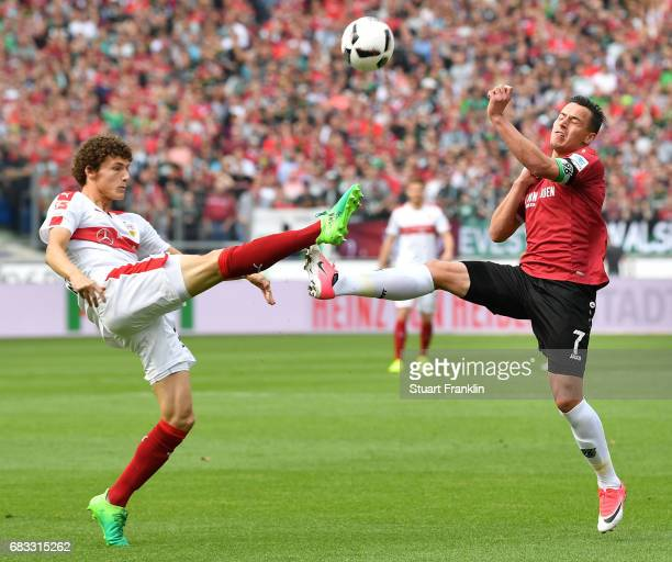 Edgar Prib of Hannover is challenged by Benjamin Pavard of Stuttgart during the Second Bundesliga match between Hannover 96 and VfB Stuttgart at...