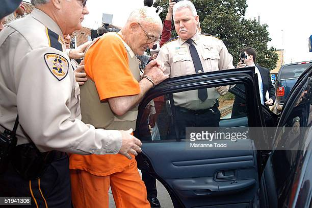 Edgar Ray Killen 79yearsold is escorted by police from the Neshoba County Courthouse January 12 2005 in Philadelphia Mississippi Killen has been...