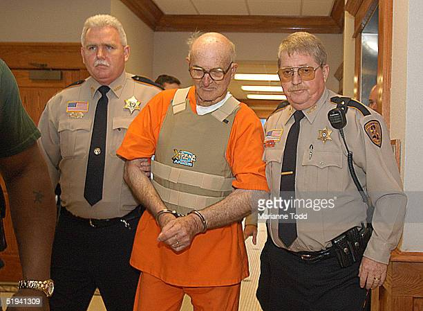 Edgar Ray Killen 79yearsold is escorted by police inside the Neshoba County Courthouse January 12 2005 in Philadelphia Mississippi Killen has been...