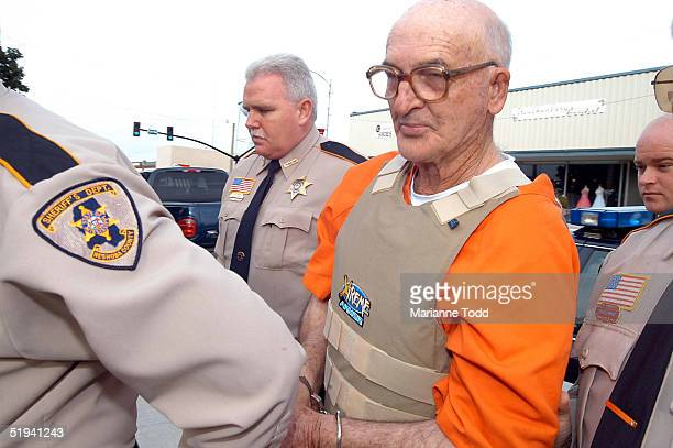 Edgar Ray Killen 79yearsold is escorted by police to the Neshoba County Courthouse January 12 2005 in Philadelphia Mississippi Killen has been...