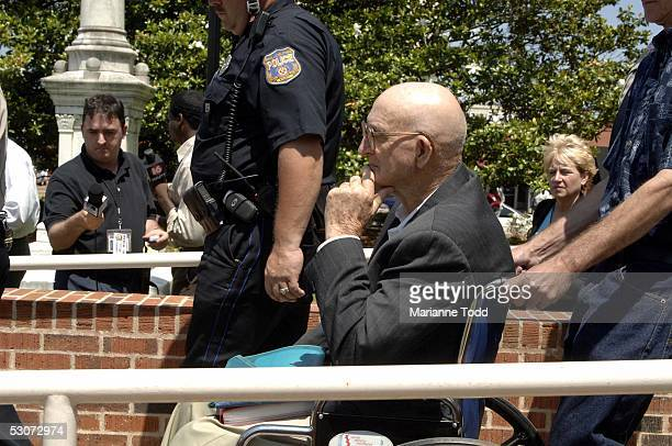 Edgar Ray Killen is escorted from the Neshoba County Courthouse by his stepson Jerry Edwards after opening arguments in his trial on June 15 2005 in...